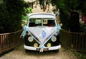 vw black betty wedding campervan in blue & white